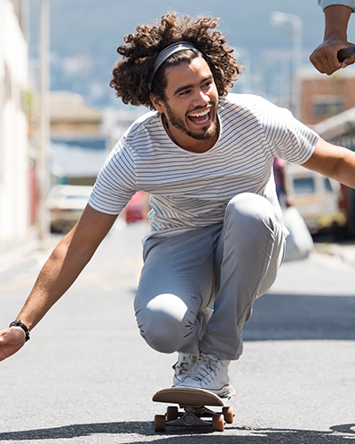 Person in a striped shirt riding a skateboard