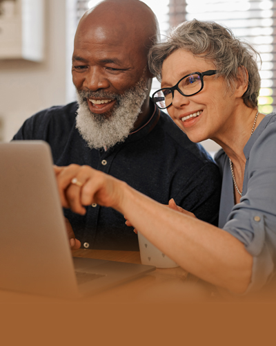 Couple working on a laptop