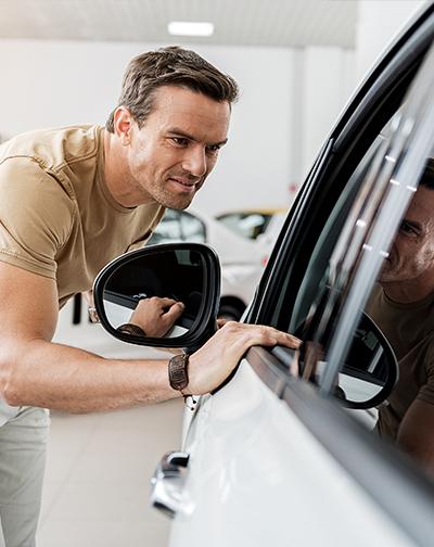 Man shopping at a car dealership